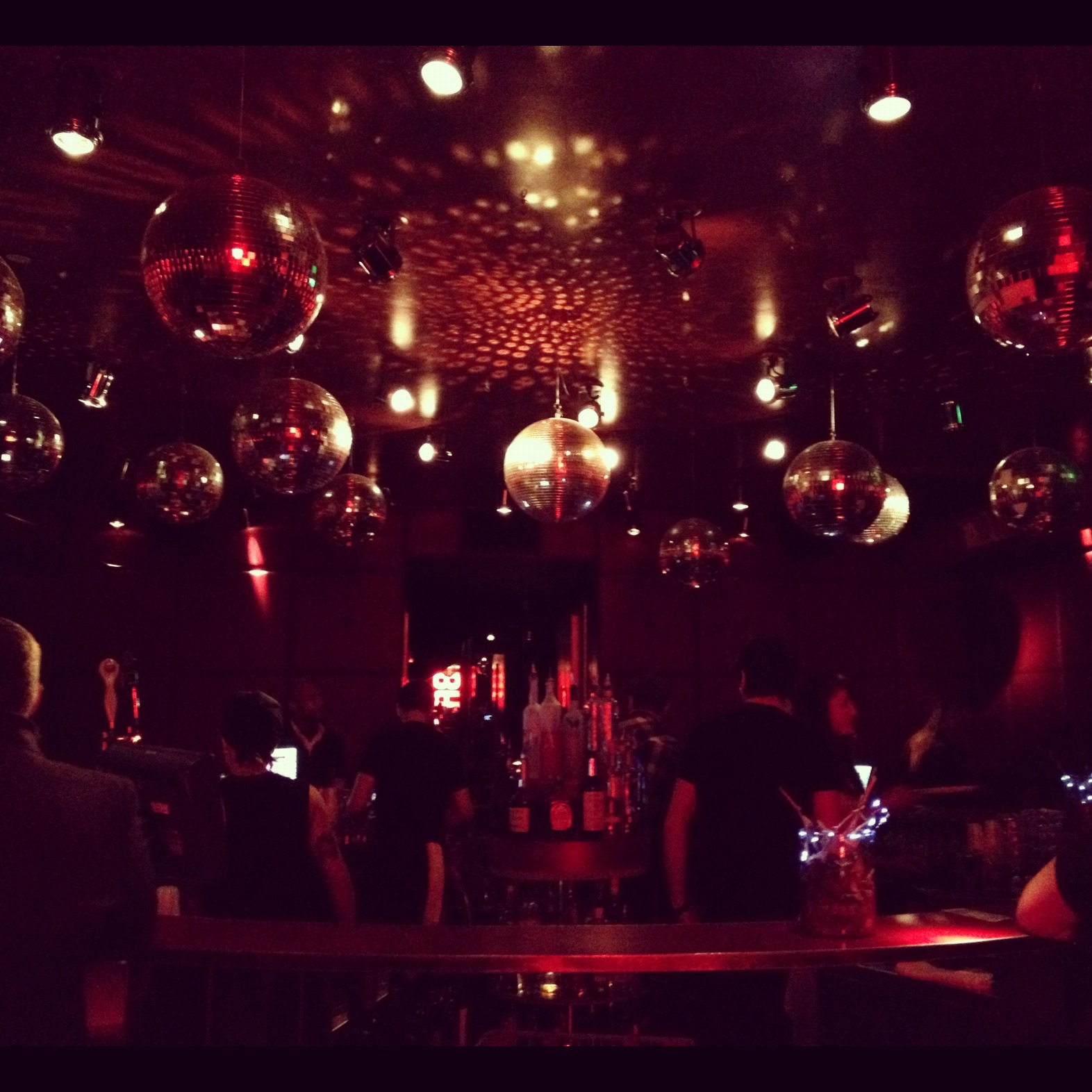 The disco balls above the bar at Bed Supperclub